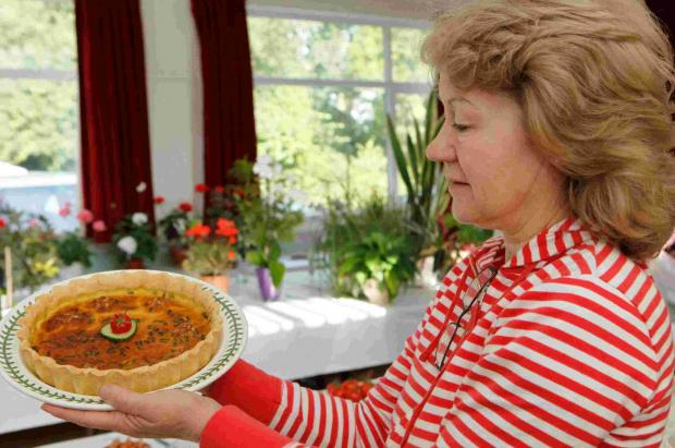 Jan Scriven checks over her stilton and walnut quiche. To see more pictures from this event, click Buy this photo.