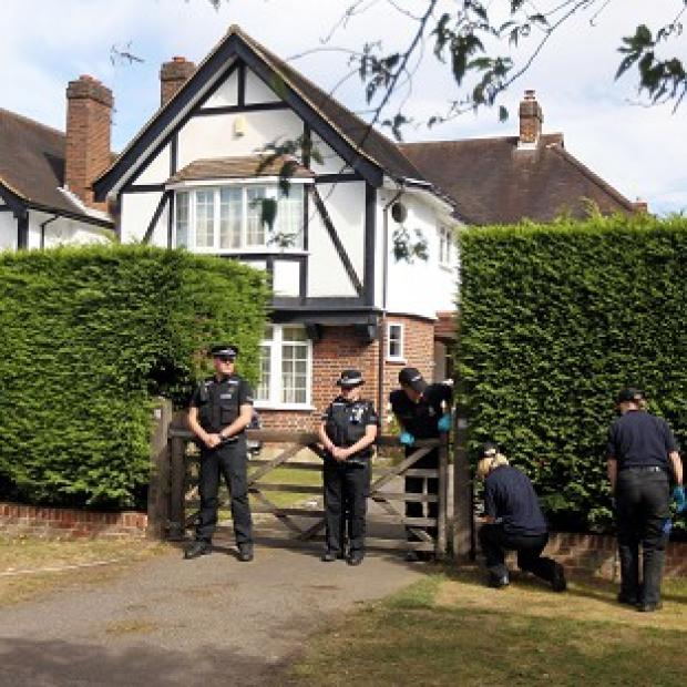 Police search outside the home of Saad al-Hilli in Claygate, Surrey