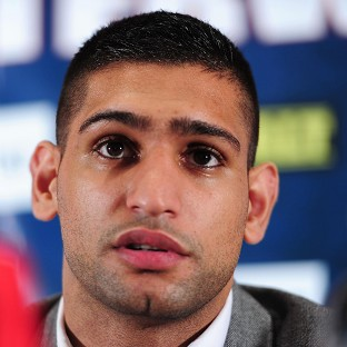 Amir Khan announced the split from his trainer on Twitter