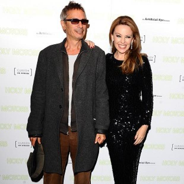 Salisbury Journal: Leos Carax (left) and Kylie Minogue arriving at the Holy Motors UK Premiere at the Curzon Mayfair, London
