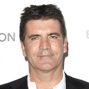Simon Cowell is hoping to boost rating on the X Factor
