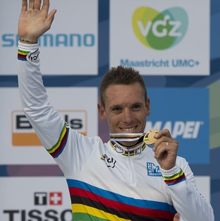 New world champion Philippe Gilbert of Belgium shows his gold medal on the podium
