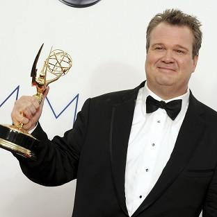 Eric Stonestreet and his Emmy award, which he won for best supporting actor in a comedy series for his role in Modern Family (AP)