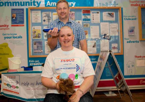 Sue shaves her head for charity