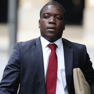 Kweku Adoboli arrives at Southwark Crown Court, where he denies charges of fraud and false accounting