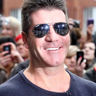 Simon Cowell has been seen out and about with Carmen Electra