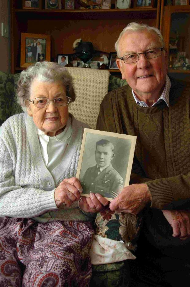 Sister and brother Freda Shave and Norman White with a photograph of their long lost brother John