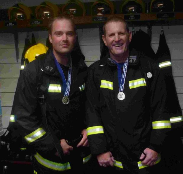 Firefighters Pete Clarke and Pete White from Fordingbridge get ready to run the New Forest Half Marathon.