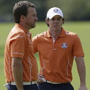 Rory McIlroy, right, and Graeme McDowell, left, will lead off Europe in the opening Ryder Cup foursomes (AP)