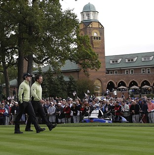Rory McIlroy, left, and Graeme McDowell walk off the first tee at Medinah (AP)