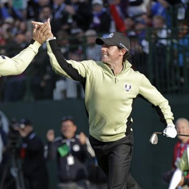 Rory McIlroy celebrates after chipping in from 40 feet on the fourth (AP)