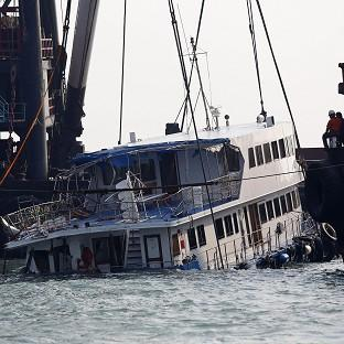 Salisbury Journal: A half submerged boat is lifted out of the water after Monday night's fatal collision near Lamma Island, off the southwestern coast of Hong Kong (AP)