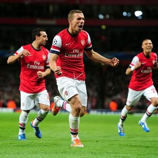 Lukas Podolski celebrates scoring Arsenal's second goal