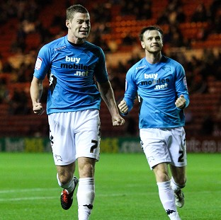 Paul Coutts celebrates scoring Derby's equaliser