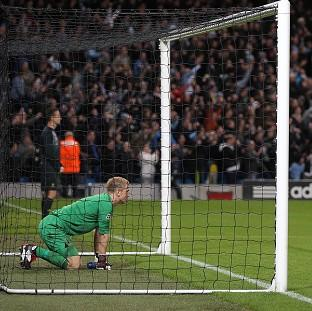 Joe Hart produced a string of impressive saves to prevent Borussia Dortmund from securing victory