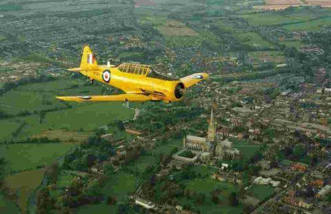 A Harvard flies over Salisbury Cathedral