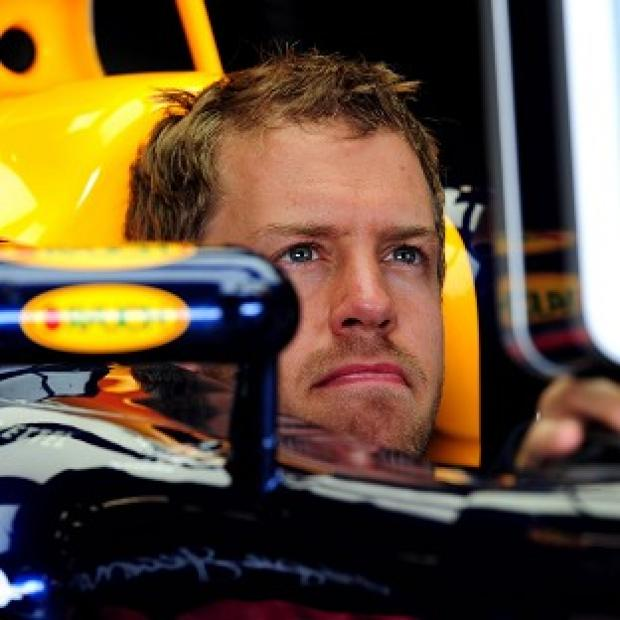Sebastian Vettel has retained his pole position at the Japanese Grand Prix despite being reprimanded