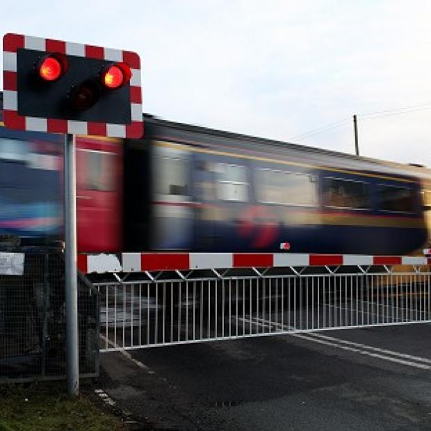 A passenger train hit a car at an unmanned level crossing near Stranraer