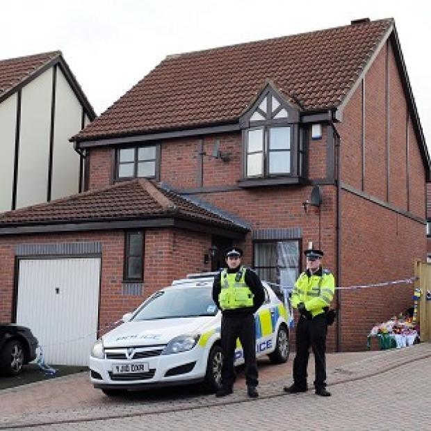 Police outside the house in Pudsey, Leeds, where Richard and Clair Smith, and their sons Ben and Aaron, were found dead