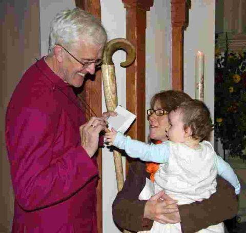 The Bishop of Ramsbury talks to Liz Hartley and her son Joseph