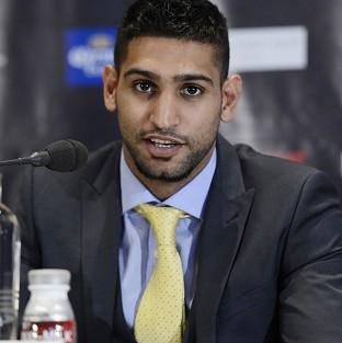Amir Khan, pictured, will face Carlos Molina in December