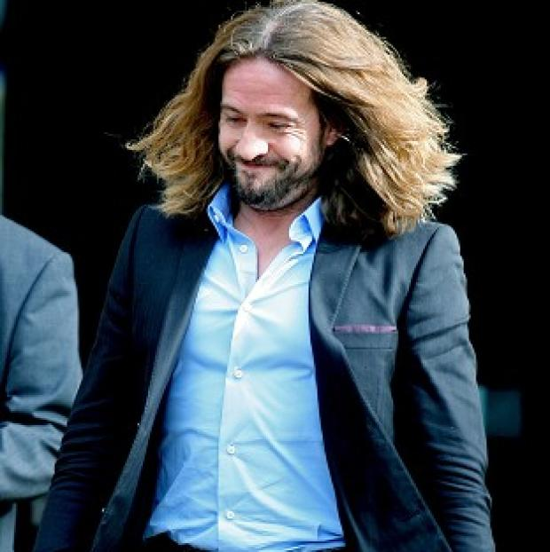 Justin Lee Collins leaves court after being found guilty of harassing his ex