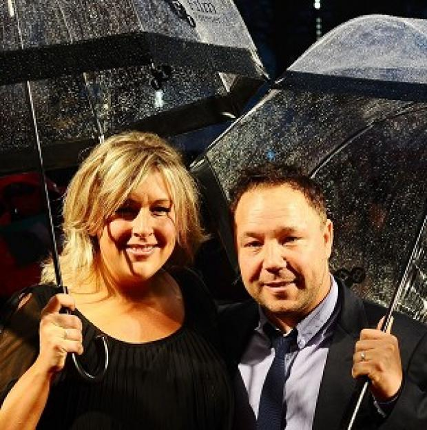 Stephen Graham and his wife Hannah arrive in the rain for the official screening of Blood at the BFI London Film Festival