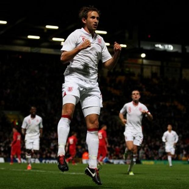 England's Craig Dawson celebrates scoring his penalty at Carrow Road