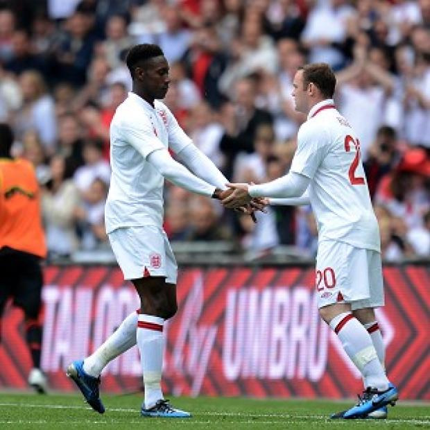 Danny Welbeck, left, believes his partnership with Wayne Rooney is developing