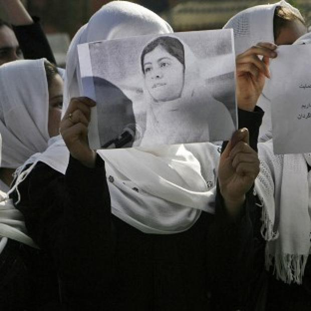 Afghan students show their support for Malala Yousafzai, who was shot by a Taliban gunman last week (AP)
