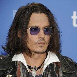 Johnny Depp is turning his hand to publishing (AP)