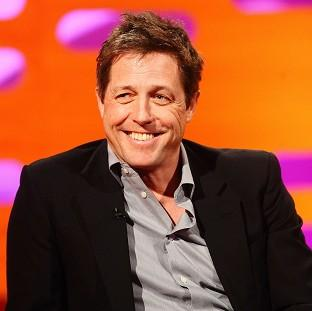 Hugh Grant was given an apology by media mogul Rupert Murdoch on Twitter