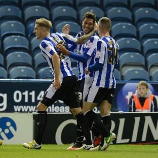 Jay Bothroyd, centre, celebrates scoring the first goal