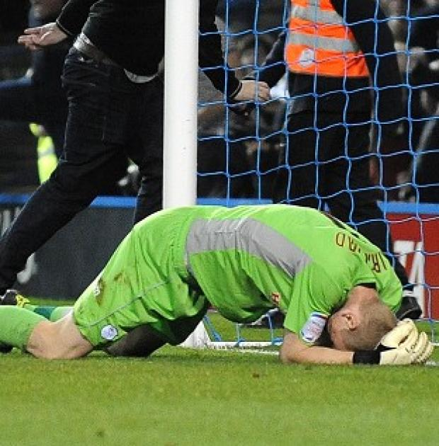 Sheffield Wednesday goalkeeper Chris Kirkland after being struck by a fan