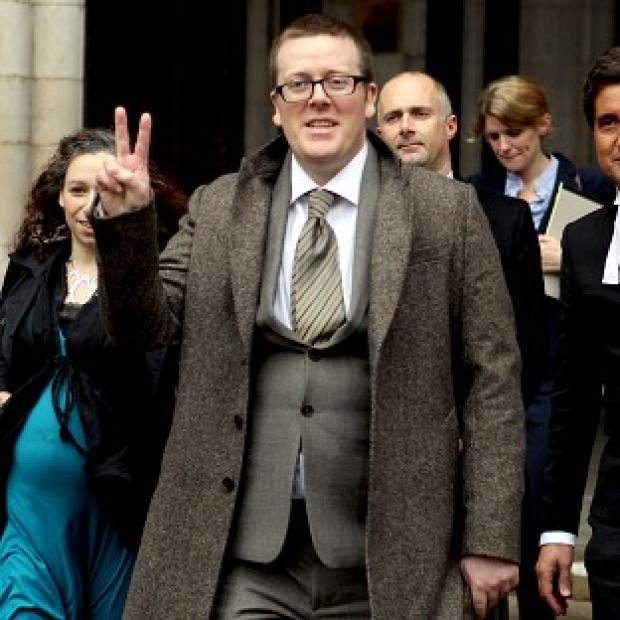 Comedian Frankie Boyle leaves the High Court after a jury concluded that he had been libelled by the Daily Mirror