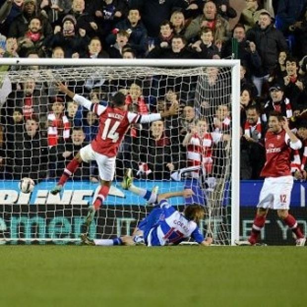 Theo Walcott, centre, scored Arsenal's sixth