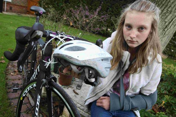 Lissie Hood with her damaged bike.