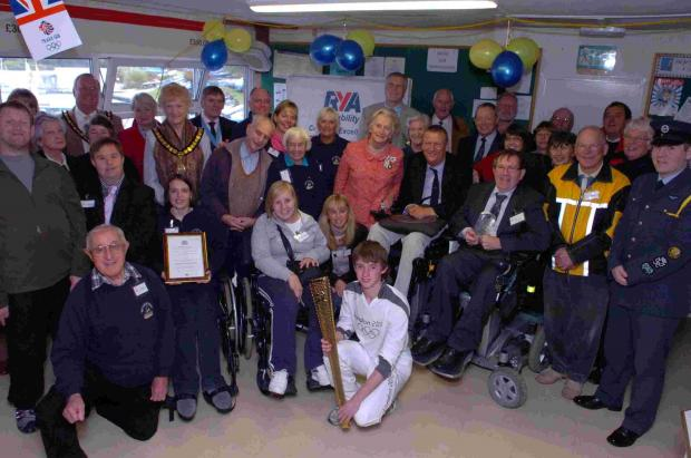 Sailability New Forest District receive the Queen's Award for Voluntary Service from the Lord Lieutenant of Hampshire Dame Mary Fagan,  at Spinnaker Sailing Club. DC2354P13