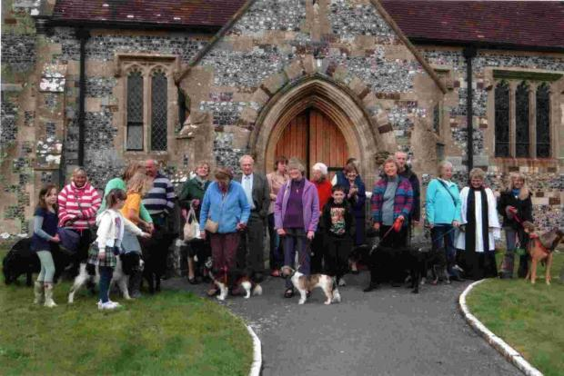 A crowd of people and pets gather for the Animals Voice annual church service. More pictures in last Thursday's Journal.