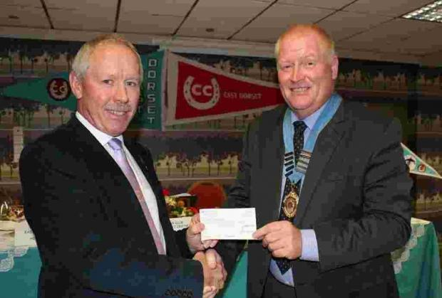 Peter Jenkins receives a cheque on behalf of Cruse Bereavement Care New Forest from Caravan Club chairman Richard Oxlade.