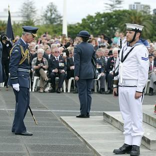 Prince Charles pays his respects after placing a wreath at the Auckland War Memorial Museum (AP Photo)