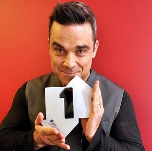 Robbie Williams has topped the UK's singles and albums charts
