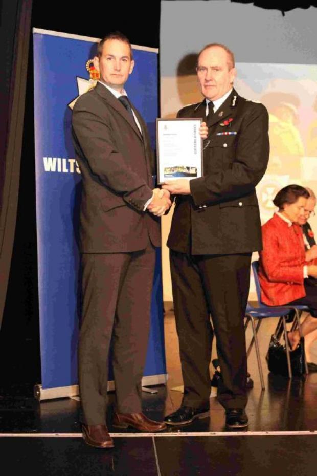 Paul Johns recieves his certificate from Chief Constable Patrick Geenty