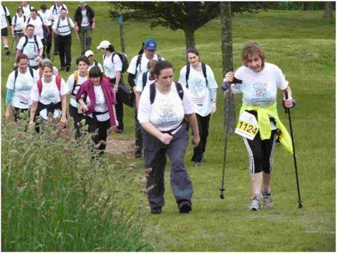 Bev Campbell (front right) leading walkers at the start of this year's walk