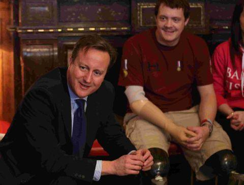 David Cameron meets injured services personnel. Picture: Getty Images.