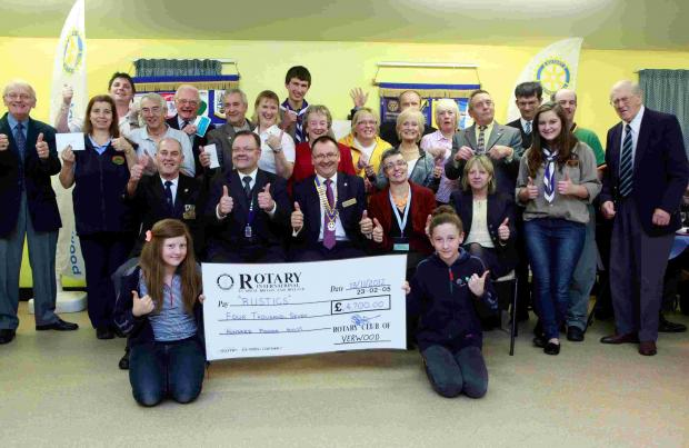 Members of the Verwood Rotary Club and some of the recipients of the cheques give a big thumbs up at the Rustic Fayre Prize Giving evening where cheques to the value of £4700 were presented.