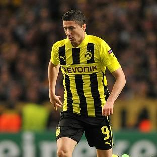 Robert Lewandowski fired Dortmund to the top of Group D