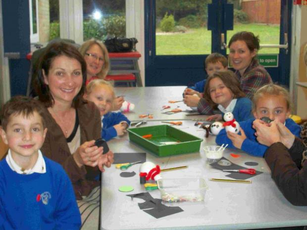 Children from St Ives First School make Christmas decorations.