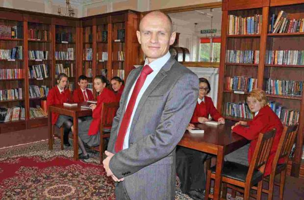 Headmaster Greg Meakin in the school's new library.