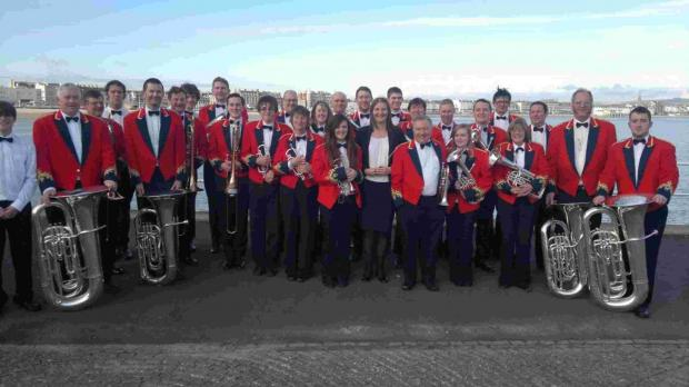 Hyde Band celebrate success in Weymouth.